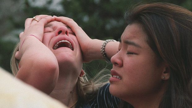 Columbine High School students overwhelmed after a shooting rampage by two students in 1999.