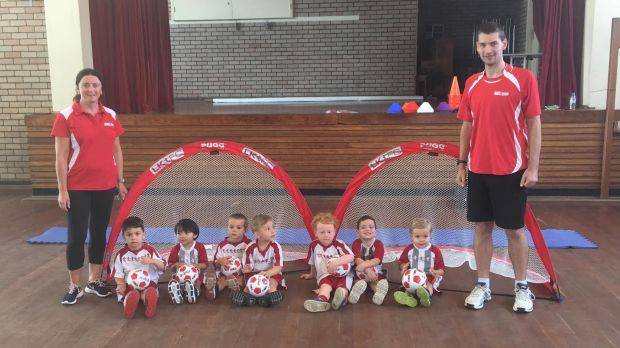 Michelle Lacey and Joseph Asbury with the Little Kickers participants.