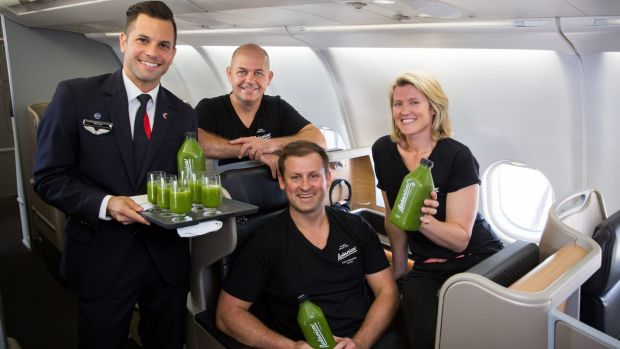 Flight Attendant Michael Cook with Botanica team Grant Swanepoel, Richard Magney and Nadia Watson on board a Qantas flight.