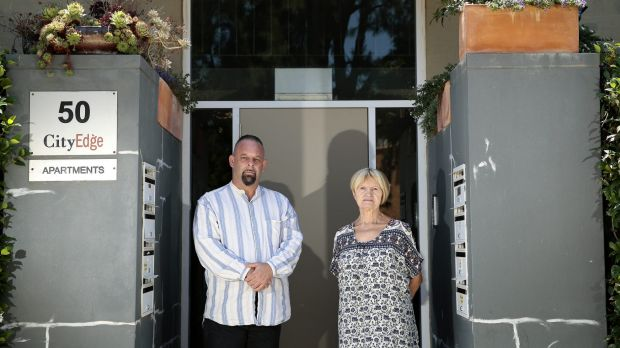 Neighbours Gerard Jenkins and Terez McGivern have been asked to remove pot plants near the front door to their building.