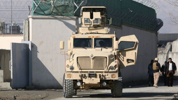 A US military vehicle blocks a road to a logistics company near the site of a deadly suicide attack in Kabul earlier ...