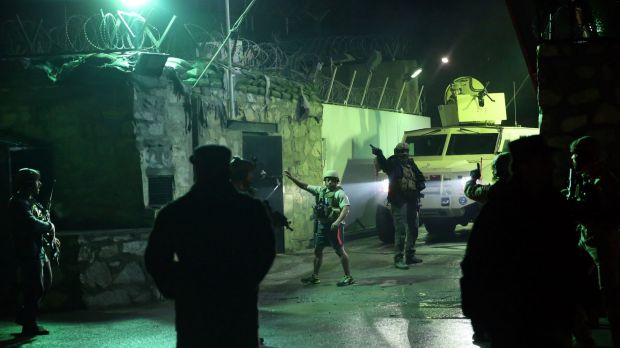 Foreign security forces at the site of a suicide attack near a compound belonging to foreigners in Kabul on Monday.