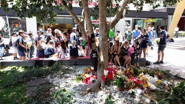 Barely a word was heard during the lunchtime memorial for Cole Miller in Brisbane's Chinatown Mall.