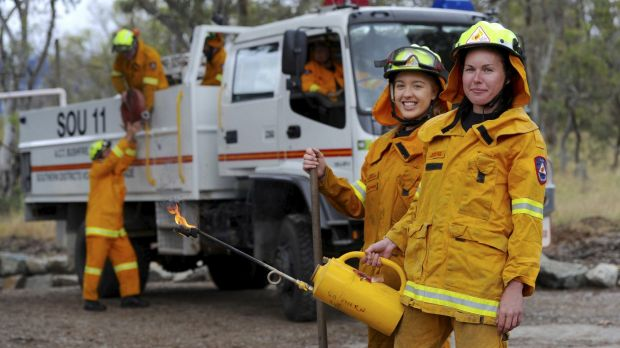 Volunteer members of the Southern ACT Bushfire Brigade, based in Tharwa are Hannah Burggraaff, 20, of Kambah, left, and ...