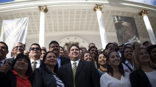 Deputies from the opposition coalition gather for an official photo outside the National Assembly in Caracas, Venezuela, ...