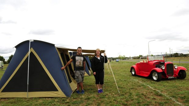 Summernats co-owner Andy Lopez and camping manager Tracy Kennedy at tent city with a 1928 Ford roadster for company.