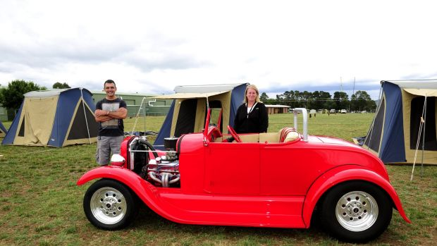Summernats co-owner Andy Lopez and camping manager Tracy Kennedy admire a 1928 Ford roadster.