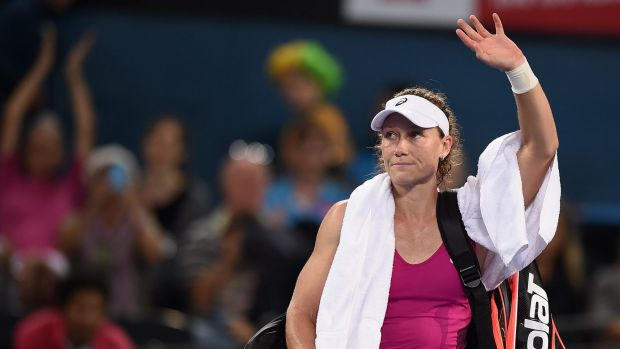 Sam Stosur leaves the court after her first-round defeat in Brisbane.