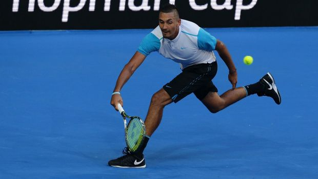 Nick Kyrgios plays a forehand against Andy Murray.