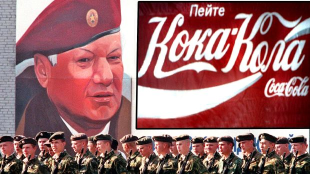 Interior Ministry troops march in front of a billboard depicting former Russian president Boris Yeltsin in 1999. The ...