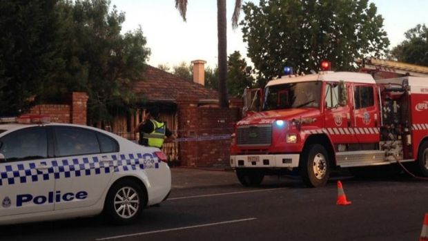 Police outside the fire-damaged Ascot Vale home of Des 'Tuppence' Moran.
