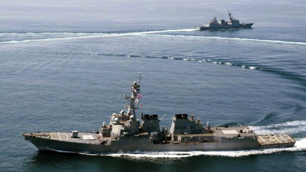 US Navy destroyer USS Lassen last year sails near Subi Reef, one of several artificial islands that China has built in ...