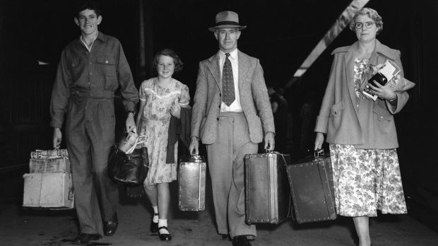 A family prepares to board a train for Broken Hill at Sydney's Central Station on January 11, 1953.
