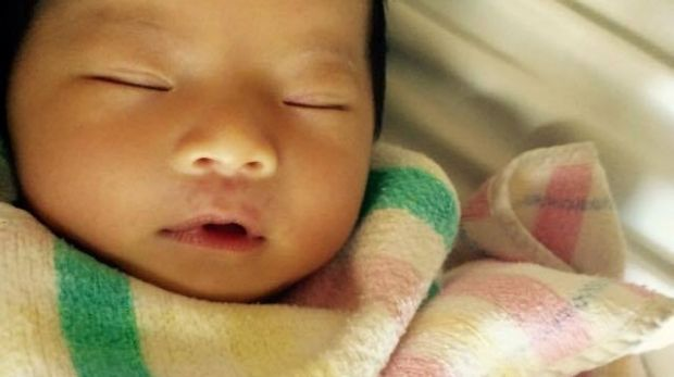 Two-month-old Queenie Xu was stabbed to death at her home in Brisbane's south on Wednesday.