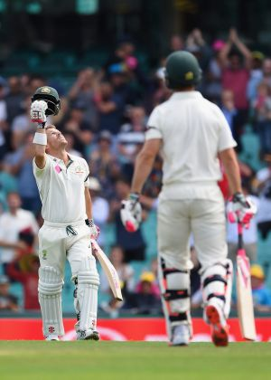 A tons of runs: David Warner celebrates after reaching his century for Australia on the last day of the Test in Sydney.
