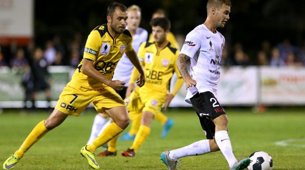 Tough task: Jacob Pepper on the run for the Wanderers against Perth in the pre-season.