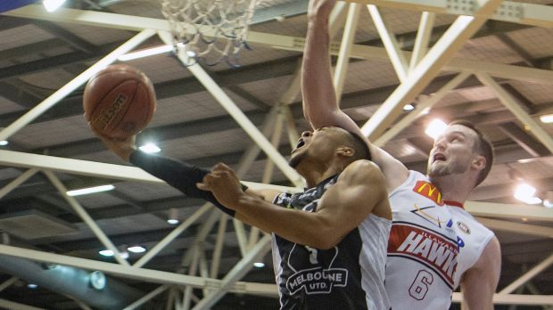 Melbourne United's Stephen Holt is fouled by A.J. Ogilvy.