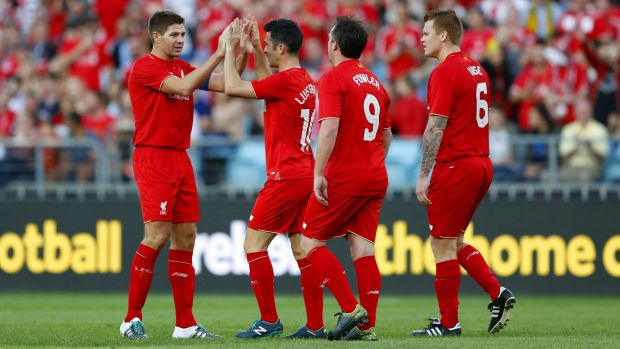 On target: Liverpool Legends celebrate Luis Garcia's goal.