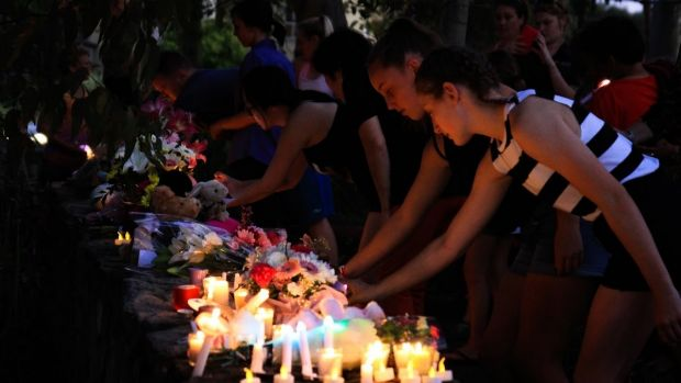 Community members attend a candlelight vigial for Queenie Xu.