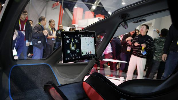 The EHang 184 is controlled by a Microsoft Surface tablet to fly a pre-determined route. A passenger simply presses ...