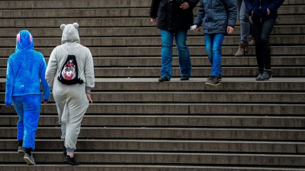 Pedestrians walk in front of  Cologne's main railway station last week after 90 women filed charges of assault.