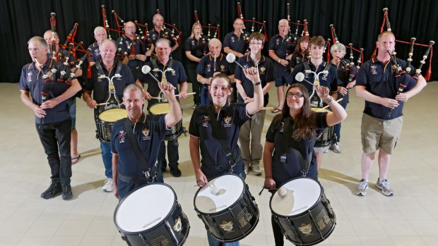 Bob Semple, 95, (behind centre drummer), and fellow members of the Rats of Tobruk Memorial Pipes and Drums, rehearsing ...