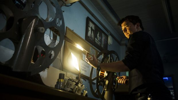 Samuel Hanson loads film at the Orpheum Picture Palace in Cremorne.