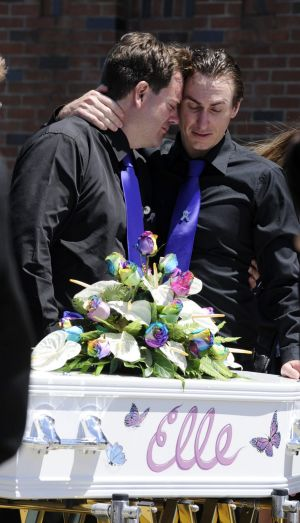 Father of Elle Underhill, Steven Underhill (left), is comforted by his brother Nathan Underhill.
