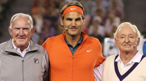 Australian tennis legends Tony Roche (left) and Rod Laver pose with Roger Federer during a charity match at Melbourne ...
