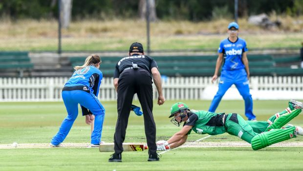 Stars' skipper Meg Lanning dives to make her ground during her unbeaten 84 against the Adelaide Strikers on Friday.