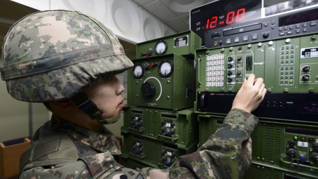 A South Korean soldier adjusts equipment used for the propaganda broadcasts at a studio near the border between South ...