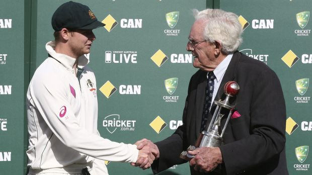 Spoils of victory: Australia captain Steve Smith shakes hands with cricket great Alan Davidson as he is presented with ...