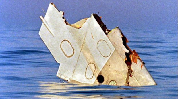 A piece of debris from TWA flight 800 floats on July 18, 1996, in the Atlantic Ocean off Long Island.