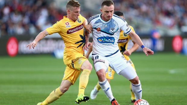 Besart Berisha of Melbourne keeps control of the ball as he is challenged.