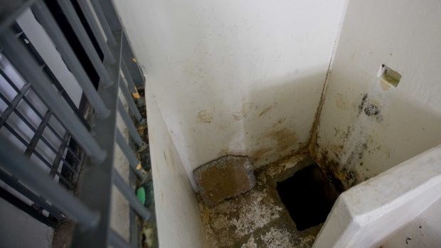 The shower area where authorities say drug lord Guzman, slipped into a tunnel to escape from the Altiplano maximum ...