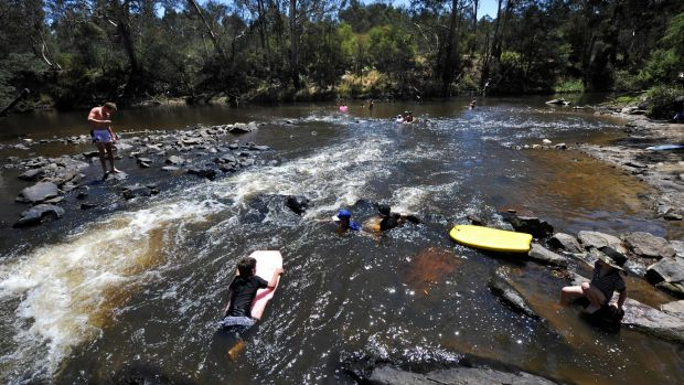 Swimmers at Pound Bend, near the Parks Victoria facility where toxic waste was washed into the river.