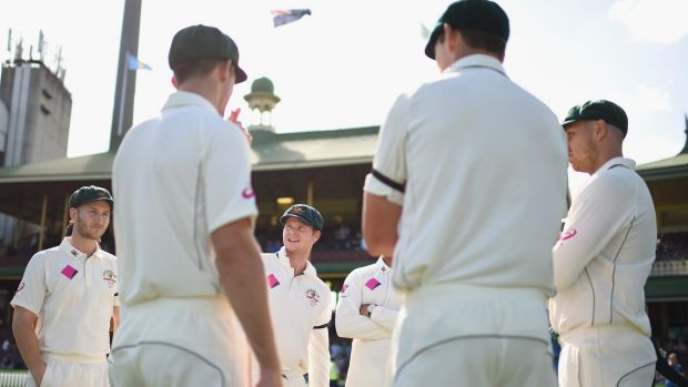 Australian captain Steve Smith with his players after the third Test ended early.