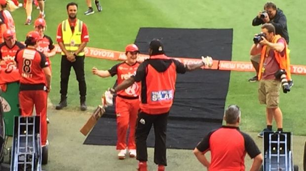 Chris Gayle is approached by Renegades WBBL player Jenny Taffs.