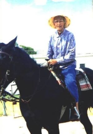 Evelyn Vigor riding a horse in her 80s.