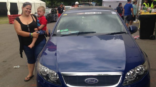 Hayley-Jade Franke, 22, with son Leo, 3, and her Ford Falcon.