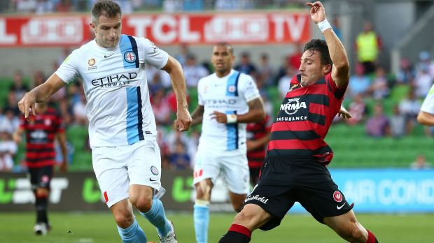 Aaron Hughes of Melbourne City and Federico Piovaccari of the Wanderers compete for the ball.