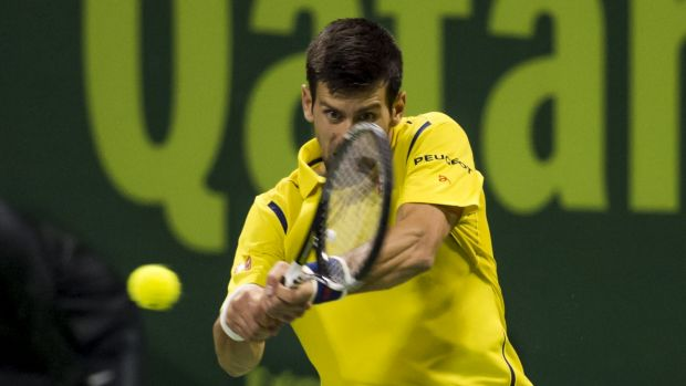 Victorious: Novak Djokovic plays a backhand shot to Rafael Nadal.