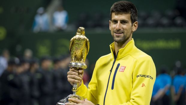 Glittering: Novak Djokovic holds the trophy after winning the men's final against Rafael Nadal at the Qatar Open.