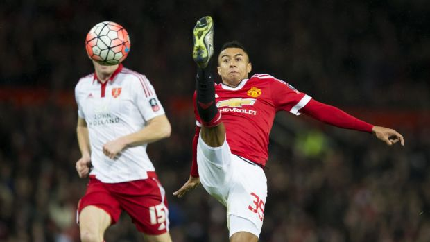 High kicks: Manchester United's Jesse Lingard fights for the ball against Sheffield United's Neill Collins.