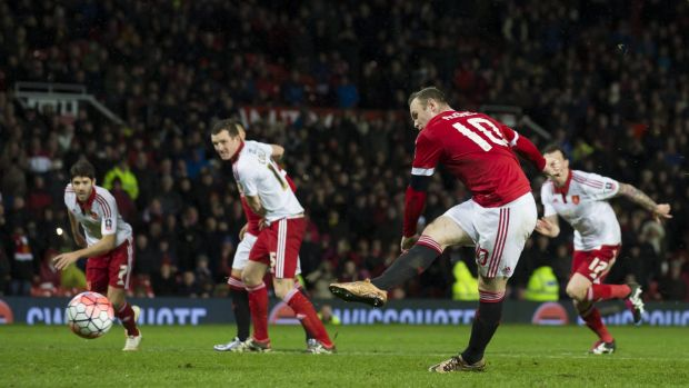 On target: Manchester United's Wayne Rooney scores a penalty during the English FA Cup third round match against ...