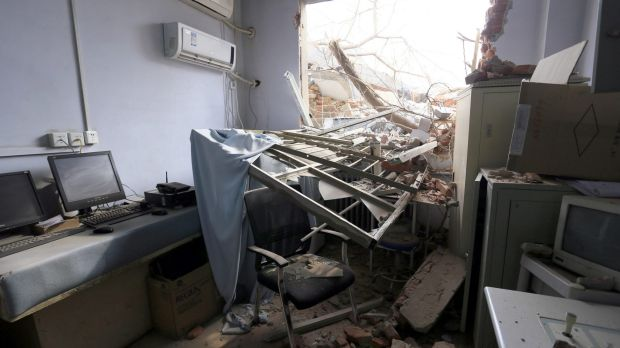 Rubble and debris spills into a room at the No.4 Hospital of Zhengzhou University after a demolition crew destroyed part ...