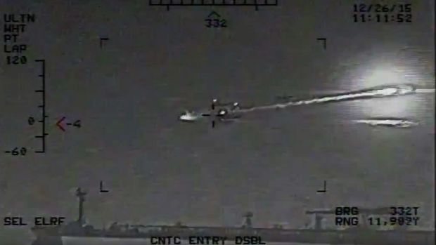 The US Navy says the video shows a rocket fired from an Iranian Revolutionary Guard vessel near warships and commercial ...