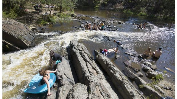 Melburnians cool off at the swimming spot on Sunday.