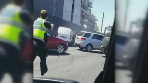 Police move in to arrest Mohamed Abdou after the stolen van he was driving was stopped on the Tullamarine Freeway on Sunday.