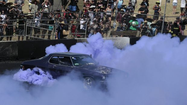 A driver takes part in the Burnout Championship finals at Canberra Summernats.